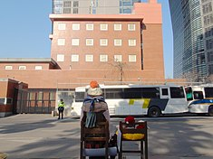 Japanese Embassy in Seoul and watched from behind a bronze statue of comfort women.JPG