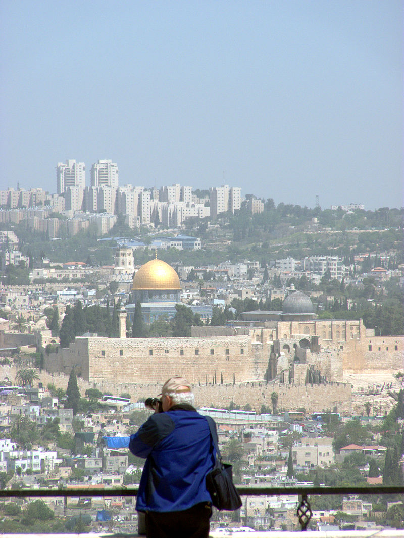 man taking a picture of the old city of Jerusalem