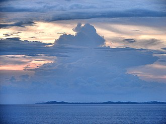 Jintotolo Channel - Silhouette of Jintotolo Island as seen from the Jintotolo Channel.