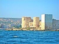 Kızkalesi sea castle seen from the water.jpg