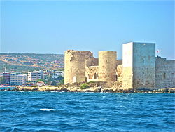 Kızkalesi sea castle seen from the water.jpg