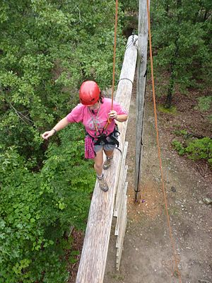 Boy Scouts of America - A Venturer traverses a COPE High Ropes course.