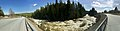 Kløftbrua Kløft bru road bridge Trondheimsveien E6 Byna river Wild spring flood Spruce forest Ulsberg Rennebu Trøndelag Norway Distorted panorama 2019-04-25 7753.jpg