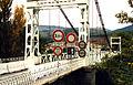 Le Poujol-sur-Orbe suspension bridge with signs.jpg