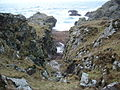 Little gulley leading to a pebble beach - geograph.org.uk - 316666.jpg