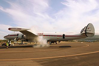 Lockheed C-121 Constellation - The former USAF 54-0154, a C-121C operated by the Historical Aircraft Restoration Society fitted with non-standard wingtip fuel tanks, starts one of its engines