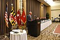 Lt. Governor Addresses the State Defense Force Conference with some flags to the left.jpg