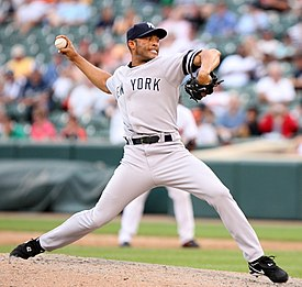 f0e4823e33437 Mariano Rivera in a gray baseball uniform and navy blue cap stands on a  dirt mound