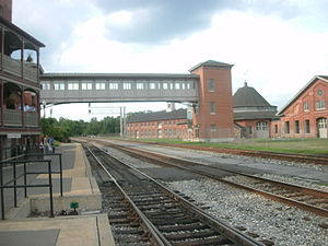 Martinsburg station - The Martinsburg station, facing the overhead walkway to the Baltimore and Ohio Railroad roundhouse as seen from the concrete platform in July 2012.