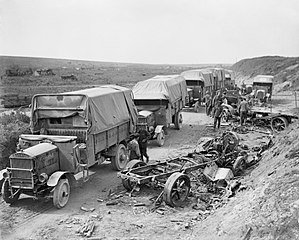 Maudslay Motor Company - British Maudslay 3-ton lorries parked up alongside the wreckage of German motor transport destroyed by shell fire during Third Army's attack on Quéant, 2 September 1918