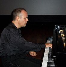 Mehmet Okonsar playing.jpg