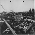 Men and dog inspect rubble left by tornado. Udall, Kansas - NARA - 283889.tif