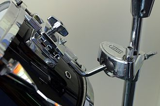 Tom-tom drum - A shell-mounted clamp attached to ball-head floor stand.