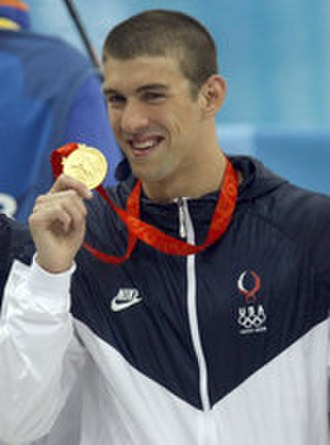 Swimming at the 2008 Summer Olympics - Michael Phelps holding his gold medal from the 4x100 relay