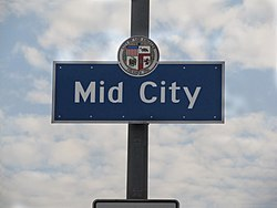 Mid-City signage located at the intersection of La Brea Avenue and the Santa Monica Freeway