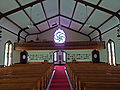 Monroe Methodist Church nave view to rose window.jpg