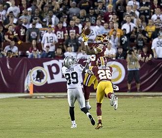 Amari Cooper - Montae Nicholson of the Washington Redskins makes an interception over Cooper