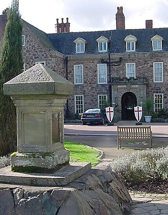 Rothley Temple - Rothley Court Hotel, which incorporates part of the former preceptory. In the foreground stands the monument recognising Rothley Temple's role in the Abolition of the Slave Trade