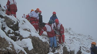 Mountain rescue - A mountain rescue team in Iran moving  a casualty.