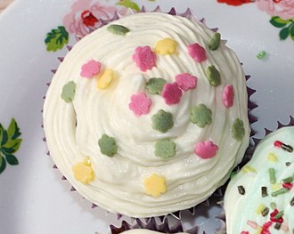 Garnish (food) - A frosted muffin garnished with confetti candy