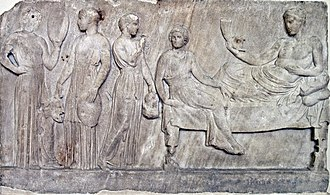 Choir - Relief, now in Athens, showing Dionysus with actresses (possibly from The Bacchae) carrying masks and drums