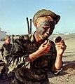 NARA 111-CCV-361-CC33824 101st Airborne LRRP team member applying camouflage Operation Harrison 1966.jpg