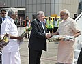 Narendra Modi being welcomed by the Governor of Kerala, Justice (Retd.) P. Sathasivam, the Chief Minister of Kerala, Shri Oommen Chandy, on his arrival at Kozhikode Airport, in Kerala on February 02, 2016.jpg