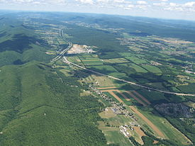 Aerial photo of Nittany Valley looking east. from Milesburg. Bald Eagle Mountain is on the left and Mount Nittany is at the upper right.