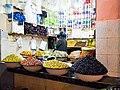 Olive vendor in Moroccan Market.jpeg
