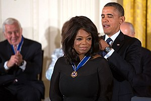 Female entrepreneurs - American entrepreneur, television host and media executive Oprah Winfrey receiving the Presidential Medal of Freedom from US President Barack Obama in 2013.