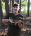 Outdoorsman with Fish.PNG