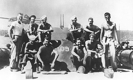 Lieutenant (junior grade) Kennedy (standing at right) with his PT-109 crew, 1943 PT-109 crew.jpg