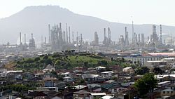 Panorama view of Hualpén, the Amarillo Hill (foreground), ENAP oil refinery, and  the Teta Biobío Norte Hill in background.