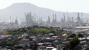 Hualpén - Panorama view of Hualpén, the Amarillo Hill (foreground), ENAP oil refinery, and  the Teta Biobío Norte Hill in background.