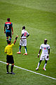 Pape Ndiaye Souaré receives a yellow card Mexico vs Senegal @ London 2012 -15.jpg