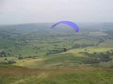 File:Paraglider launch Mam Tor.ogv