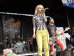 Lead vocalist Hayley Williams (center), drummer Zac Farro (left) and bassist Jeremy Davis (right) perform at the Vans Warped Tour in August 2007
