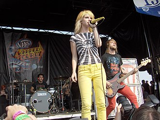 Paramore - Zac Farro (drums), Hayley Williams (lead vocalist), and Jeremy Davis (bass guitar), performing on the 2007 Vans Warped Tour at the Tweeter Center at the Waterfront in Camden, New Jersey.