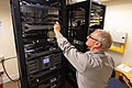 Park IT specialist checking on park servers (48266874597).jpg