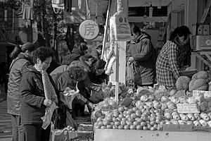 People are buying fruits.jpg