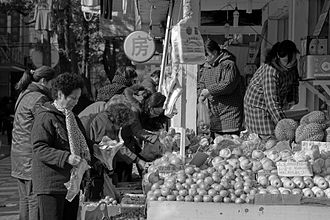 Consumer - Consumers buying fruit in Nanjing, China