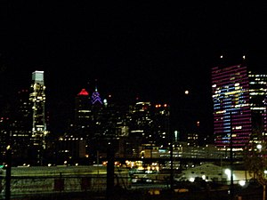 Cira Centre - Cira Centre illuminated with the Phillies logo the night after they won the 2008 World Series. The newly completed Comcast Center (Philadelphia) is on the left.