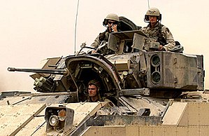 M2 Bradley - U.S. Army soldiers head out on a mission in their M2A2 ODS, seen here fitted with explosive reactive armor boxes, Iraq, October 2004