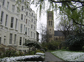 Notting Hill - Nos 1–9 Colville Gardens, now known as Pinehurst Court, showing All Saints' church in the background