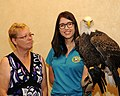 Posing for picture with Bald Eagle. (10597090803).jpg