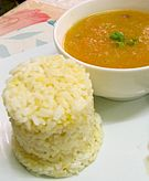 Carrot-potato soup served with rice