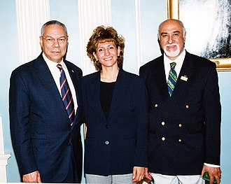 Iraq at the 2008 Summer Olympics - In this 2004 photo, former U.S. Secretary of State Colin Powell stands with then-National Olympic Committee of Iraq executive committee member Dr. Iman Sabeeh, center, and then-newly elected President of the NOCI Ahmad al-Samarra'i.