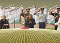 Pranab Mukherjee paying homage at the Samadhi of the former Prime Minister, Pandit Jawaharlal Nehru on his 123rd birth anniversary, at Shantivan, in Delhi. The Chief Minister of Delhi, Smt. Sheila Dikshit is also seen.jpg