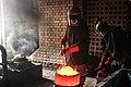 Prepairing molten metal (bronze).jpg