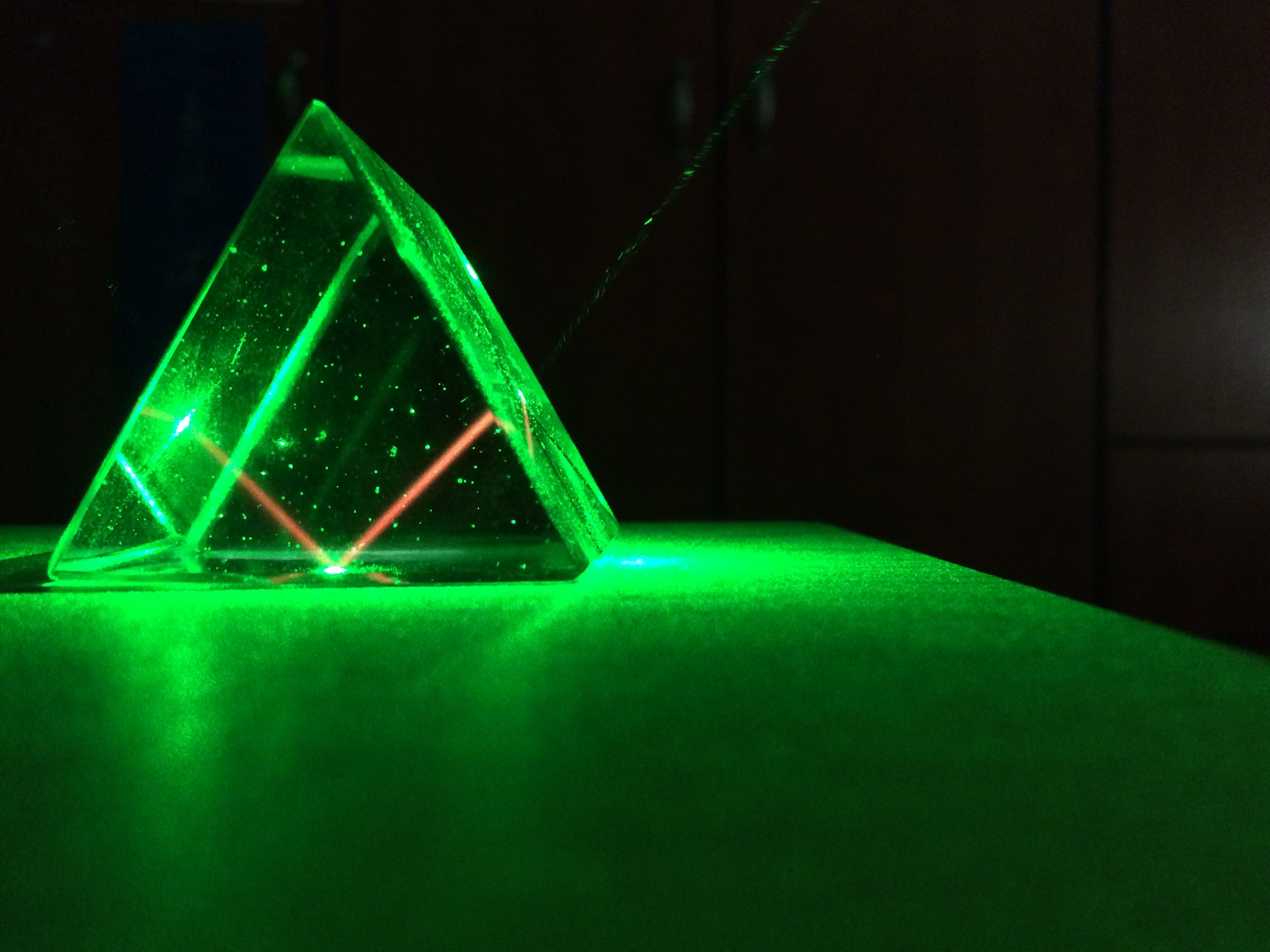 refraction and prism Refraction is responsible for dispersion in rainbows and many other situations  ( a) a pure wavelength of light falls onto a prism and is refracted at both surfaces.